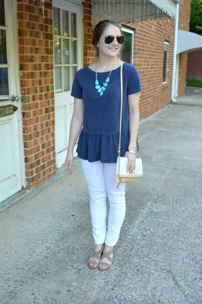 Dark blue peplum short-sleeved top with white jeans