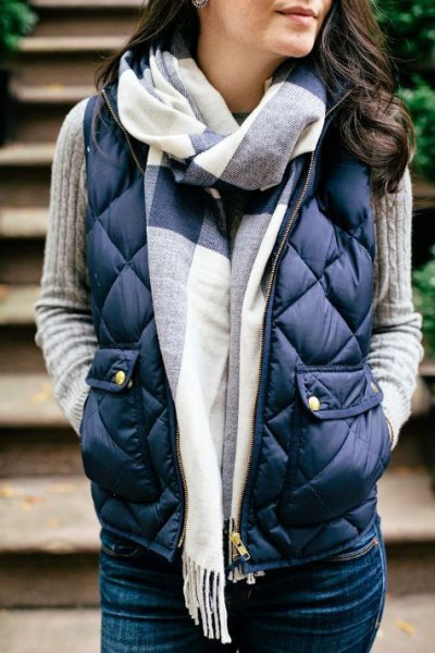 Dark blue quilted vest with gray ribbed sweater