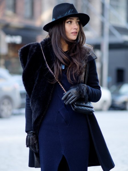 Dark blue, ribbed sweater dress with a black faux fur coat