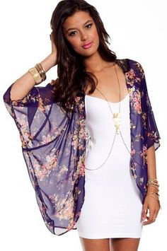 Dark blue, sheer cape with a floral pattern and white mini dress