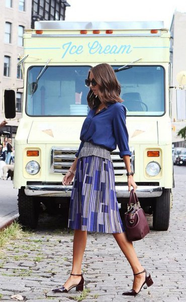Navy blue shirt with a printed midi skirt and black heels