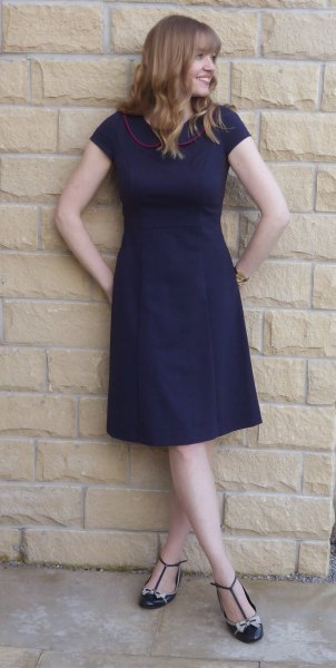 Dark blue, short-sleeved fit and knee-length dress with strappy flats