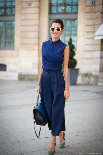 Dark blue shirt with sleeveless collar and matching, cropped pants with wide legs