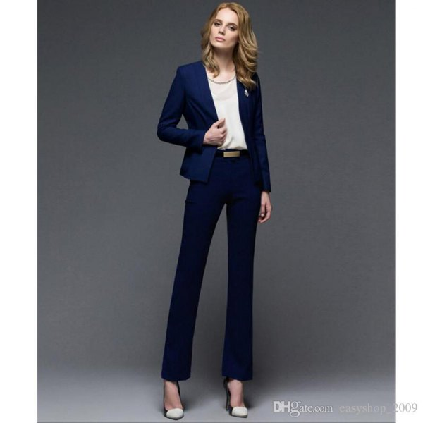 Dark blue slim fit blazer with chiffon top and dress pants with straight legs