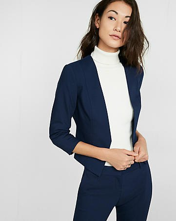 Dark blue slim fit blazer with a white sweater with a false neckline