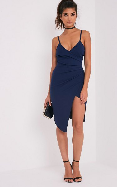 Dark blue spaghetti strap midi dress with a slit in the front