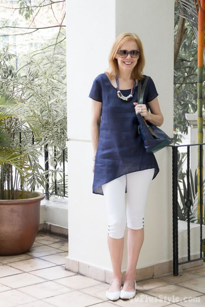 Dark blue tunic top with white, short cut leggings