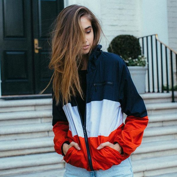 Navy blue white and red color block windbreaker with light blue boyfriend jeans