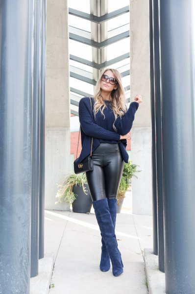 Navy cardigan with black leather gaiters and over-the-knee boots