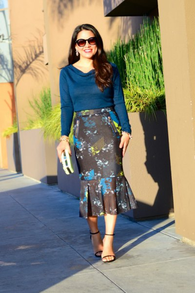Dark blue sweater with a cowl neckline and black midi mermaid skirt with a floral pattern