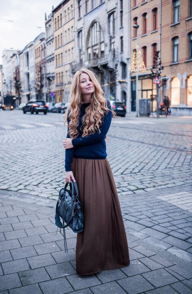 Dark blue knitted sweater with a round neckline and gray khaki long skirt
