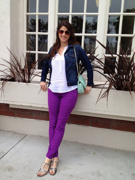 Navy denim jacket with white top and purple jeans