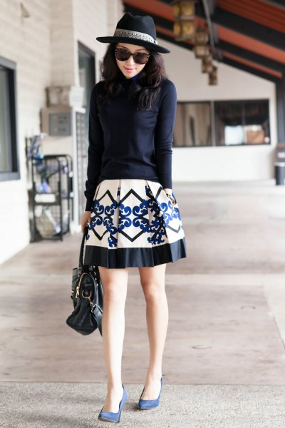 Dark blue knitted sweater with a white and black printed skater skirt