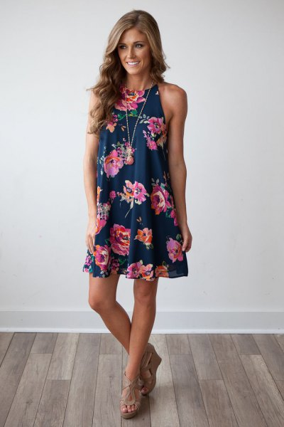 Dark blue mini swing dress with a floral pattern and nude heeled sandals