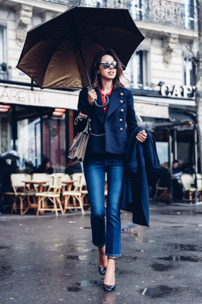 Navy military blazer with blue jeans with cuffs