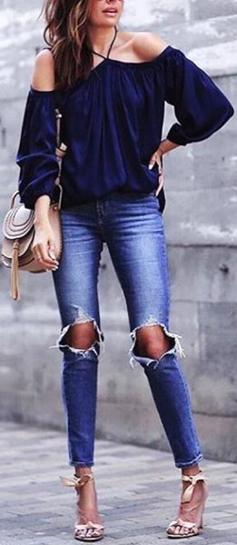 Off-the-shoulder navy blouse with ripped skinny jeans