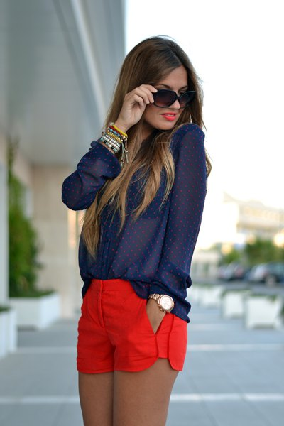 Navy dotted shirt with buttons with red shorts