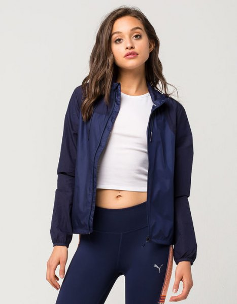 Navy sports coat with white short t-shirt and running shorts