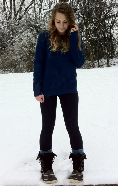Navy sweater with black leggings and snowshoes