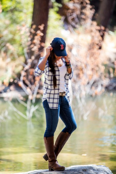 Navy white checked shirt, knee high leather boots made of brown leather