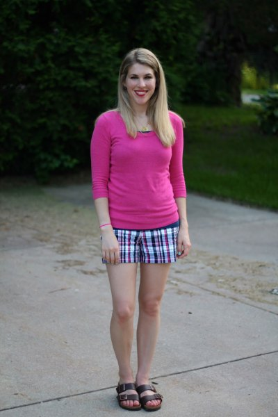 Neon pink fitted sweater with black and white checked shorts