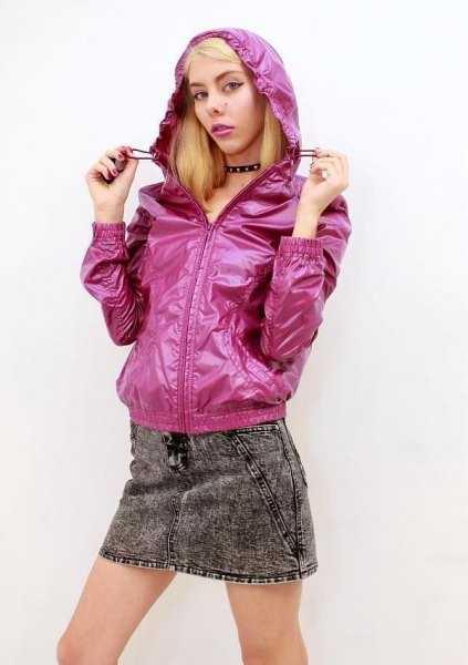 Neon pink hooded jacket made of nylon with a gray mini skirt