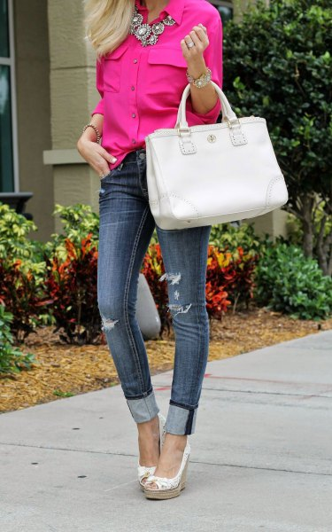 Neon pink shirt with statement chain and skinny jeans with cuffs