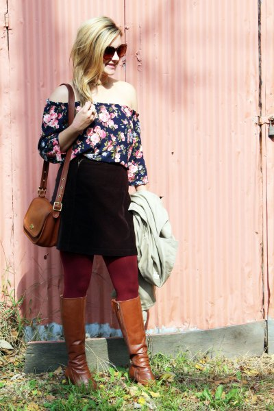 Off-the-shoulder black and white blouse with a floral pattern, black skirt and brown boots