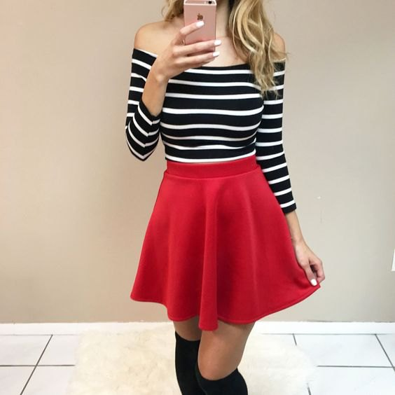 Strapless black and white striped long-sleeved shirt with a red skater skirt
