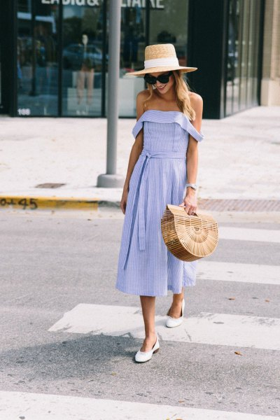 Off-shoulder fit and a flared midi dress with a straw hat