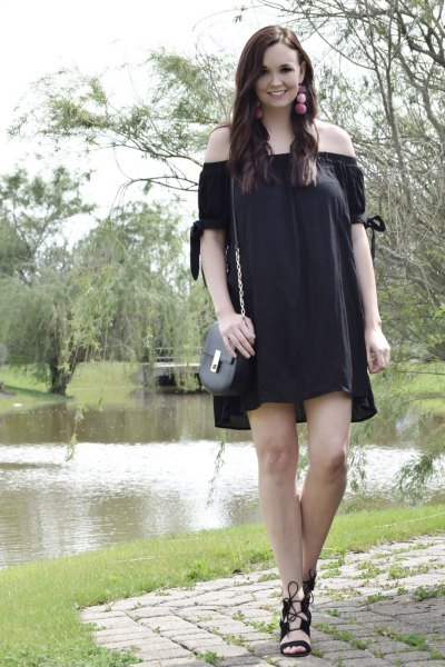 Off-the-shoulder mini dress with black lace-up sandals