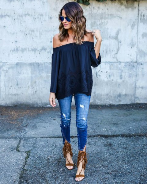Off-the-shoulder dark blue top with brown strappy sandals