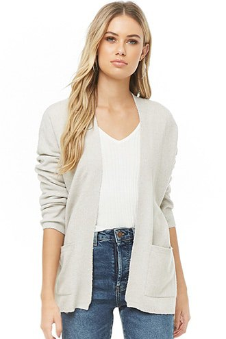 Cream-colored cardigan with a V-neck T-shirt and blue jeans