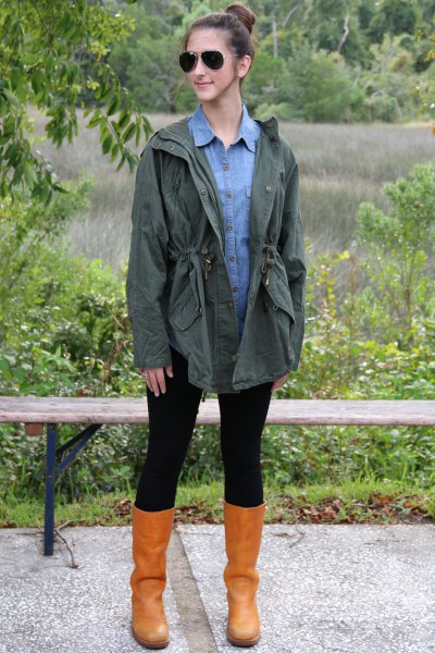 Olive green boyfriend jacket with a light blue chambray shirt with buttons and leather boots