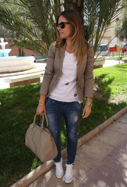 Olive green khaki blazer with a white sweater and blue jeans