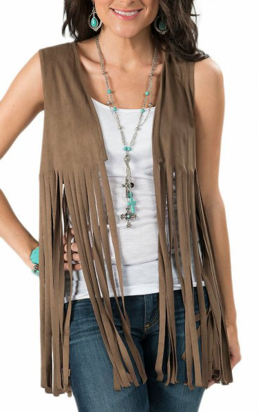 Olive green hippie vest made of suede with dark jeans