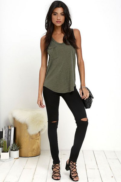 Olive green tank top with ripped black skinny jeans