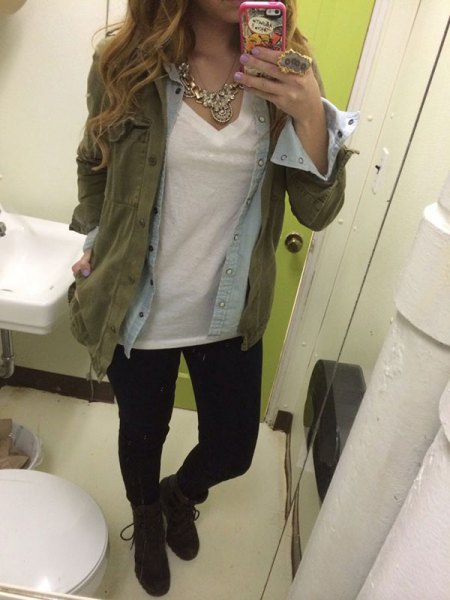 olive green military jacket with light blue chambray shirt