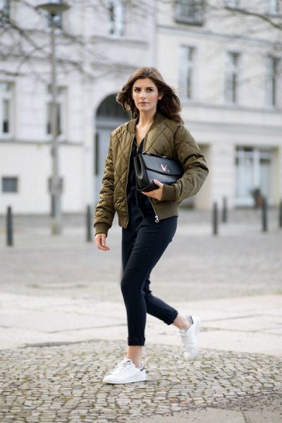 olive quilted bomber jacket with slim fit jeans with black cuffs