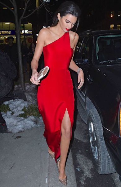a shoulder-high, split red dress