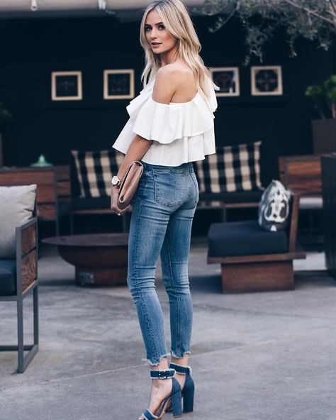 A ruffled shoulder blouse with short skinny jeans and jeans heels