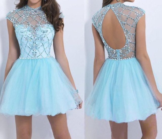 Mini fit with an open back and a light blue and silver flare dress