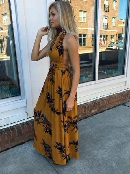 Backless maxi summer dress with a floral pattern in orange and black
