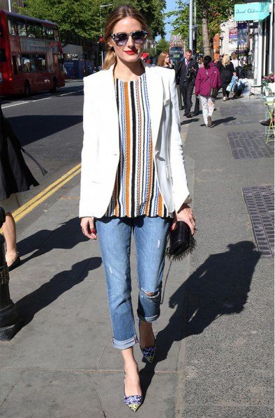 orange and black vertical striped blouse and jeans with cuffs