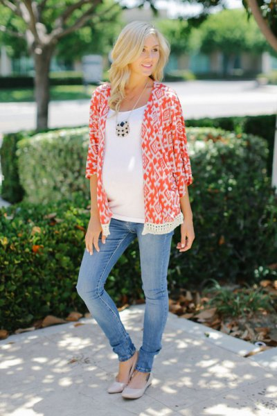 orange and white maternity cardigan with tribal print and blue slim fit jeans