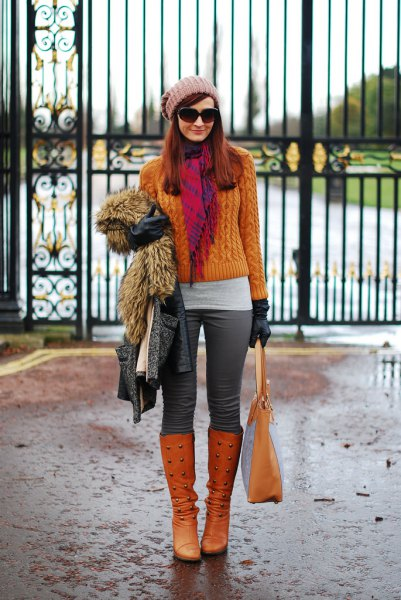 orange cable knit sweater with matching knee-high boots