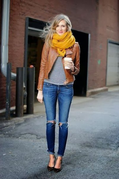 orange-colored chiffon scarf with a brown motorcycle jacket and black and white smart T-shirt