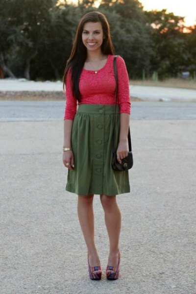 Orange, figure-hugging lace top with half sleeves and a green knee-length skirt
