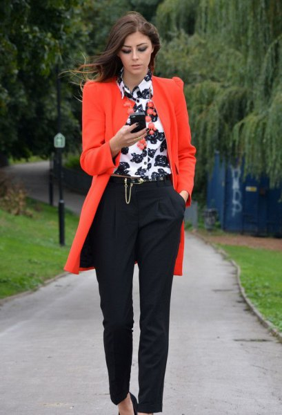 Orange long blazer with white and black printed shirt with buttons