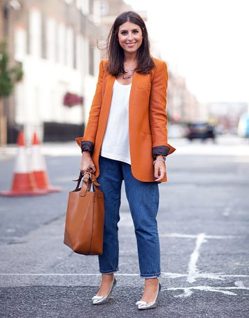 Orange long blazer with a white vest top and wide cut mom jeans